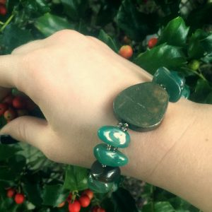 A Power-Bracelet handmade with tumbled Green Agate beads and a Pyrite medallion.