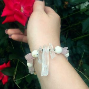 A Power-Bracelet handmade with Rose Quartz chips, Clear Quartz points, and Howlite beads!
